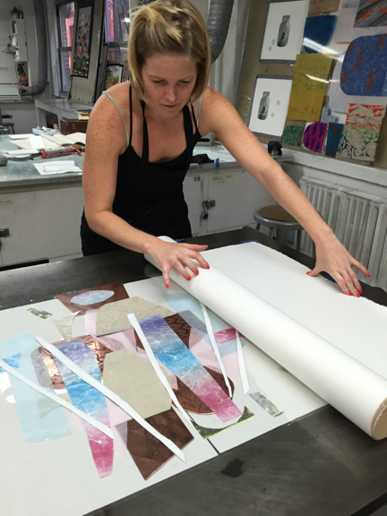 Leah working on a print in her studio.