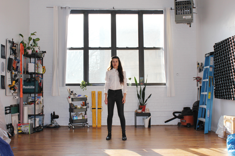 Amanda Martinez (above) in her Bushwick studio. Photo courtesy of the artist.