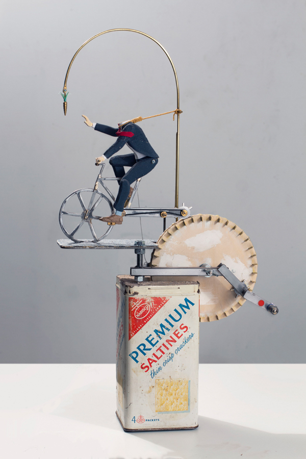 Executive Toy, Reach for the Stars,  2018 Found saltines tin, concrete, plywood, steel, denim, cotton, sandpaper and brass 24.5 x 13 x 6 inches