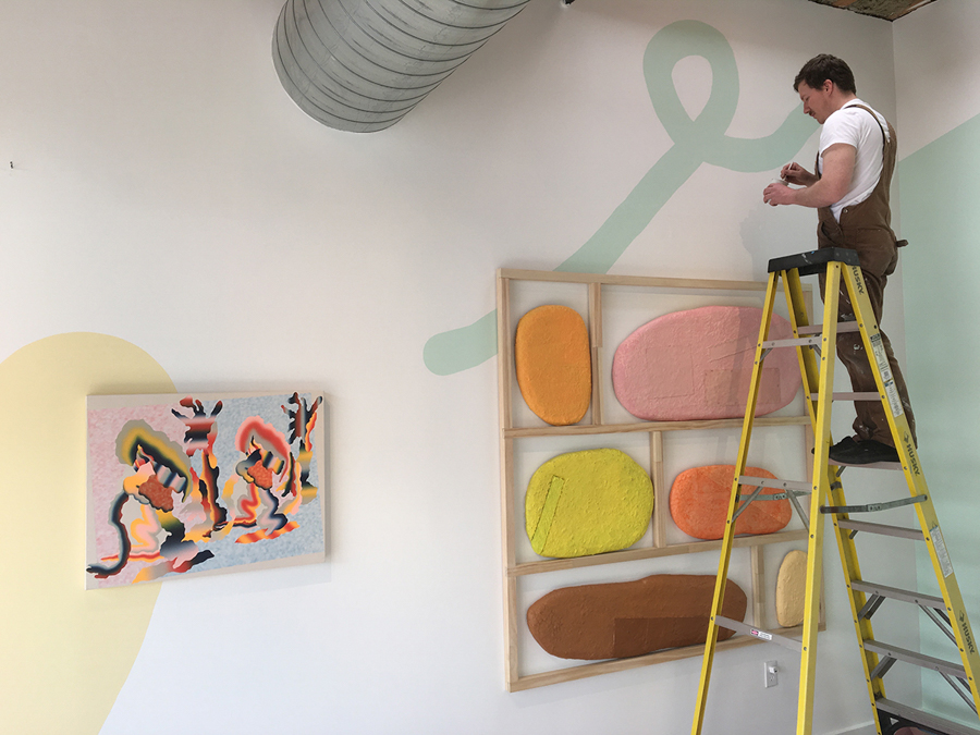 Installing  Slippery Slope , pictured: Nathan Randall Green and Morgan Blair