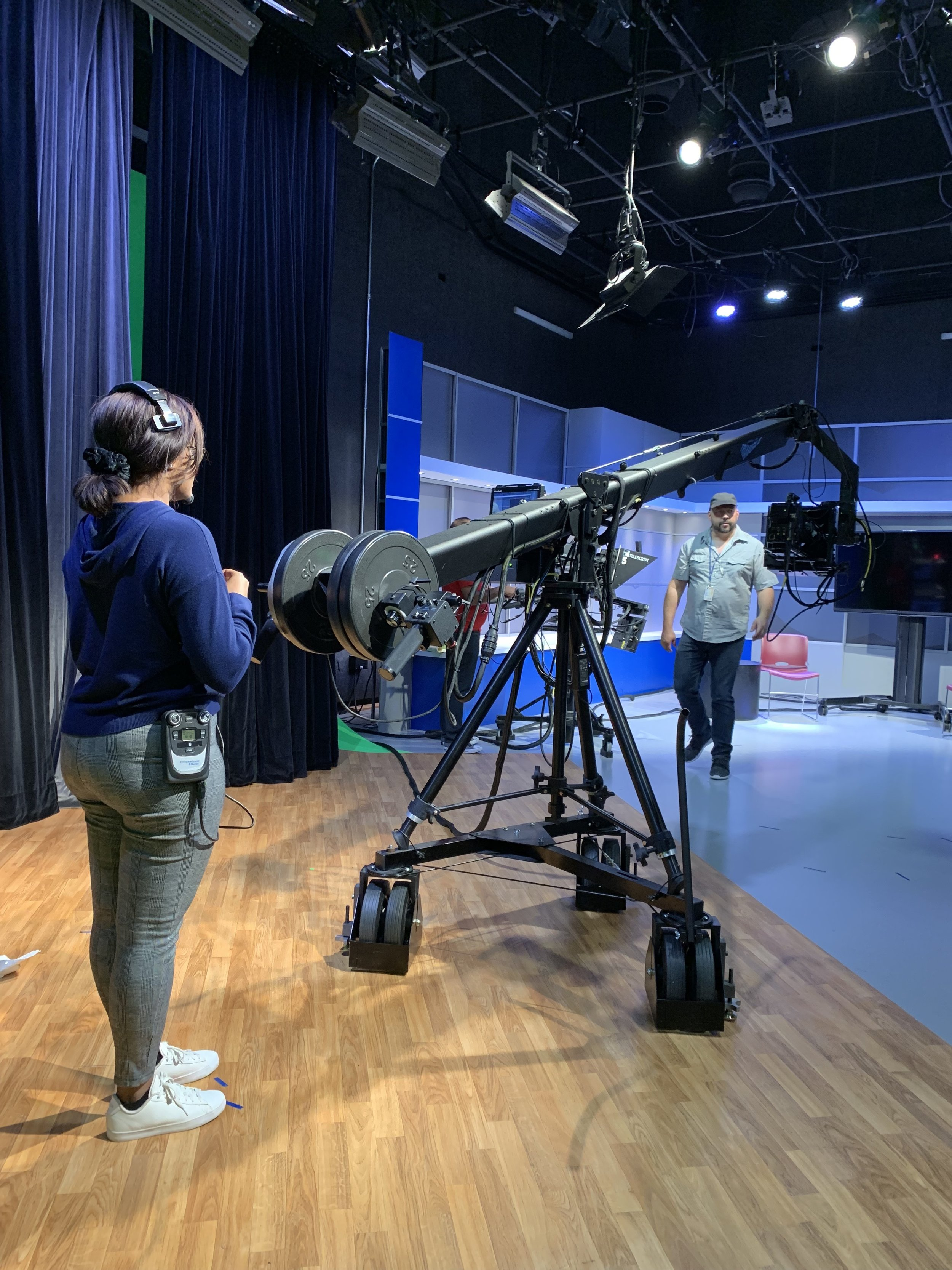 A member of the production team preparing for the live event broadcast