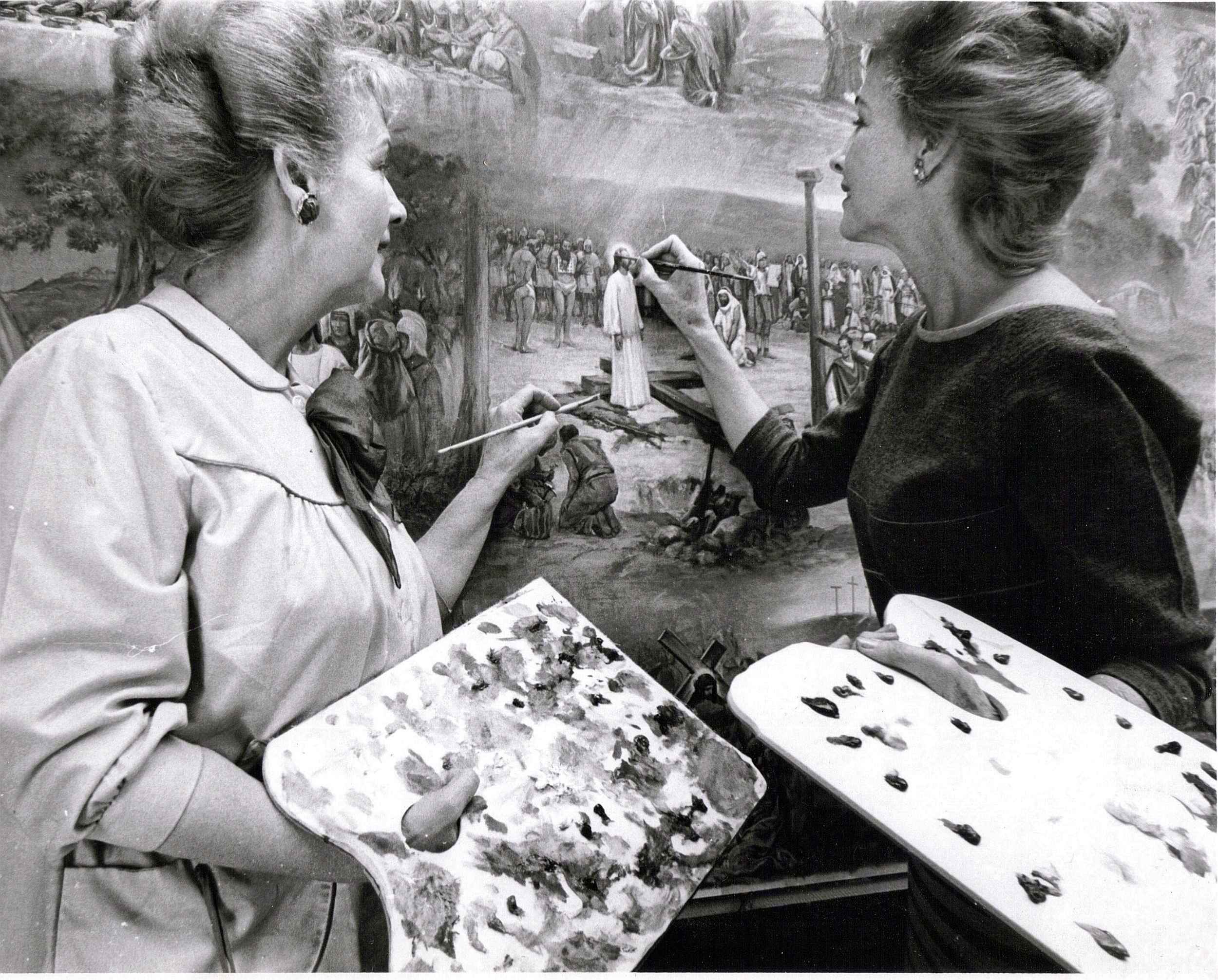 "Venetia (left) and Daphne working on the painting for ""The Life of Christ"" mosaic at Forest Lawn Memorial-Parks and Mortuaries in Covina Hills. Courtesy Christopher Kennedy."