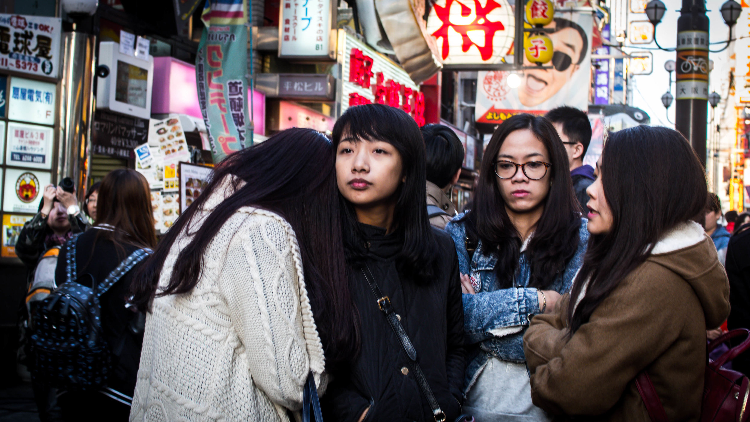 Possibly not Japanese, but the theme is the same. The compositional imperative for me was the emotional content. The girls, shoulder craving head came first, then the stronger friends support and later I noticed the contradictory happy face in the back ground to add some irony.