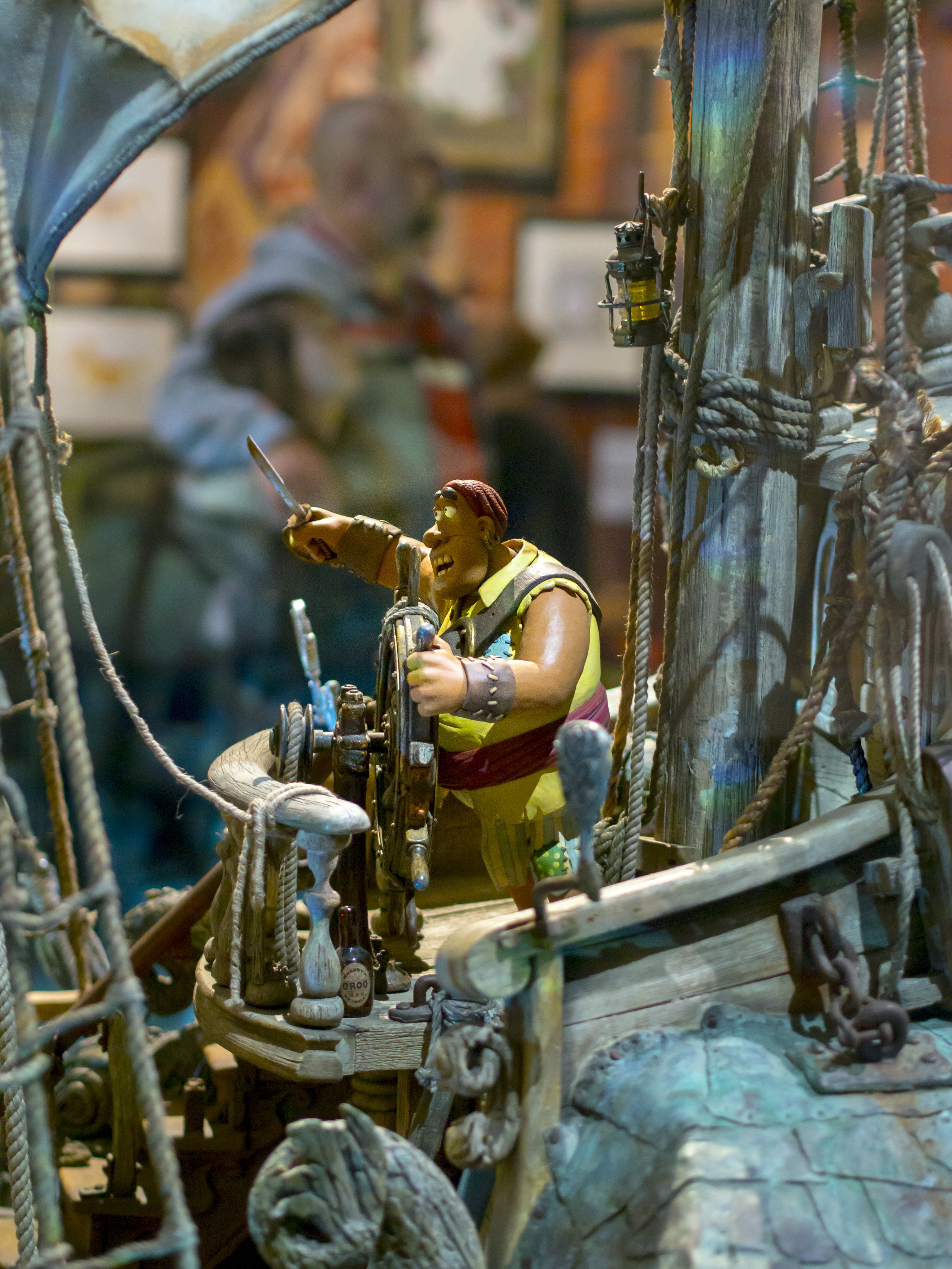 The figure behind the wheel is about 20cm tall and the ship is complete from stem to stern.