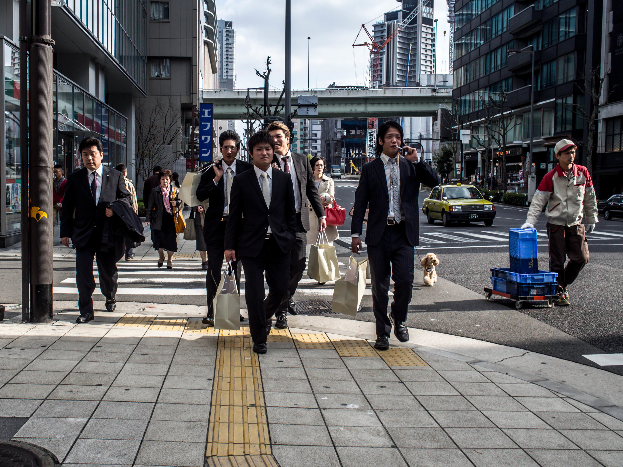 All three of the above images were taken on a brassy spring afternoon in Osaka. The width of the streets suited the 25mm well. The harsh editing was my look at the time. I really have to re visit them.