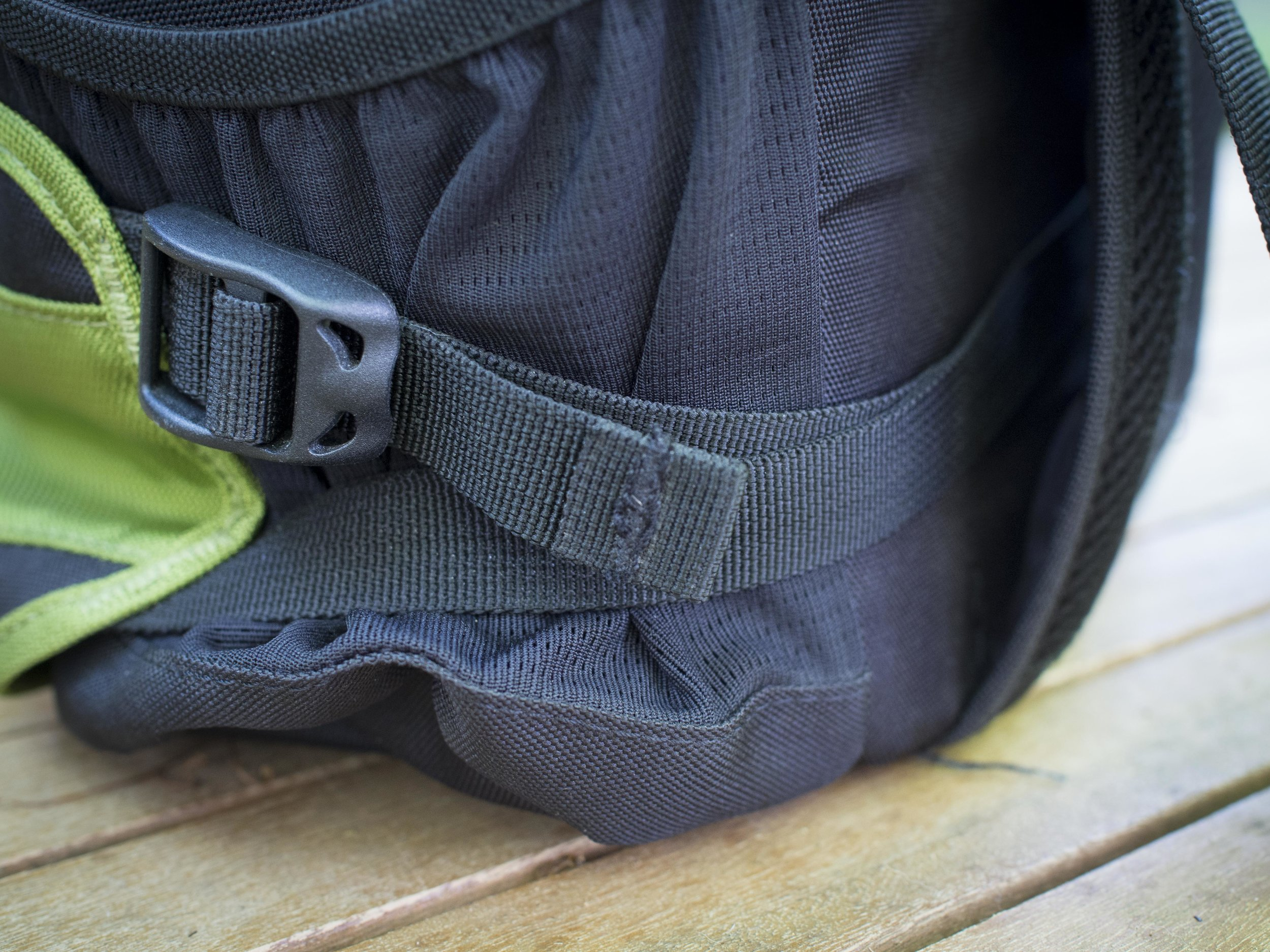 Under the strap at each end is the standard water bottle pocket which could be used as small lens pouches with some padding added.
