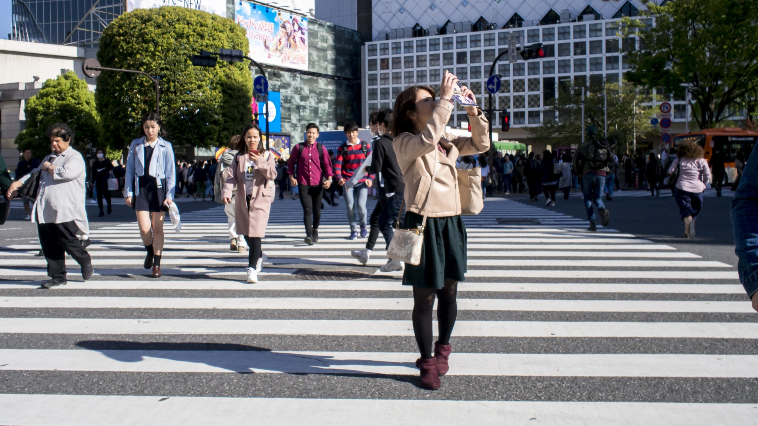 But it is nearly impossible to shoot Shibuya without catching someone else's selfie.