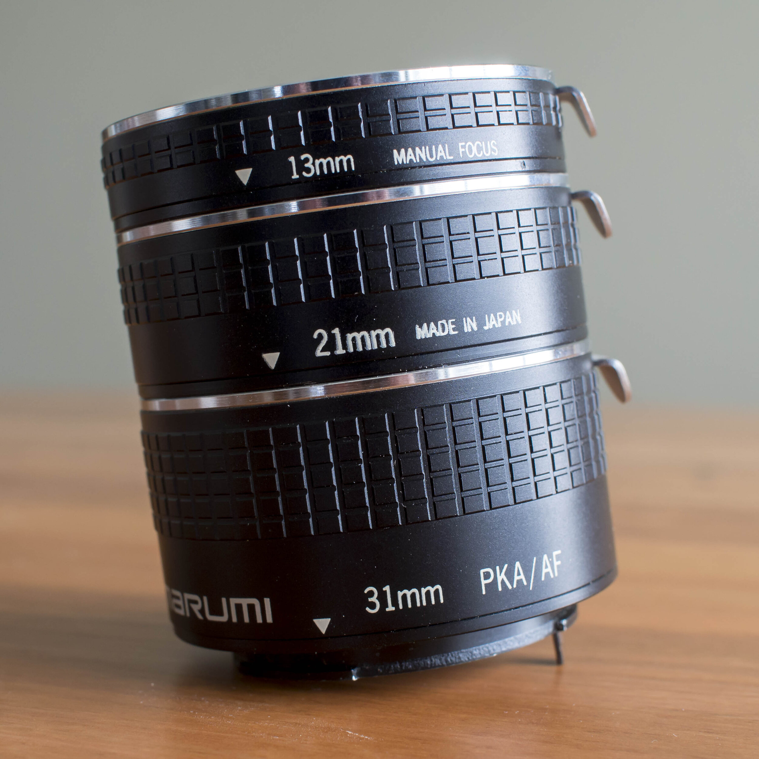 The usual set of three extension tubes. The shortest one will have little effect on longer lenses except to rob them of infinity focus, but the longer one on a shorter 50mm lens would likely produce 1:2 or closer magnification at the cost of about 1 and a 1/2 full shutter speeds of light.
