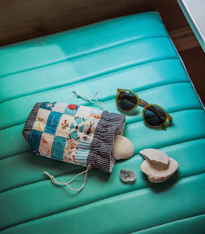 Beachcomber Drawstring Bag // Shot on a vinyl seat.