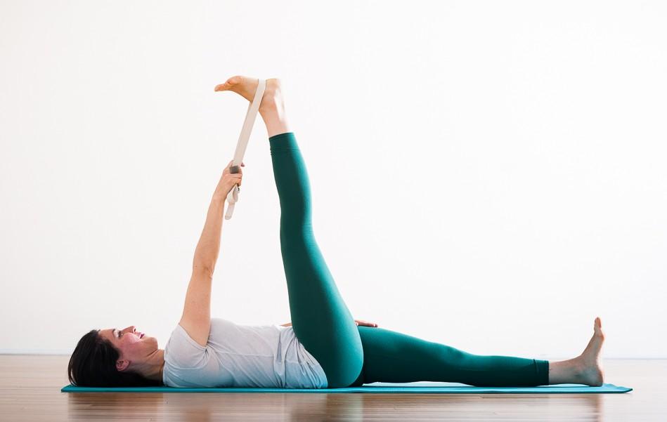 Purna Yoga teacher Letitia Walker in supta padangusthasana.  www.liveyoganow.com .
