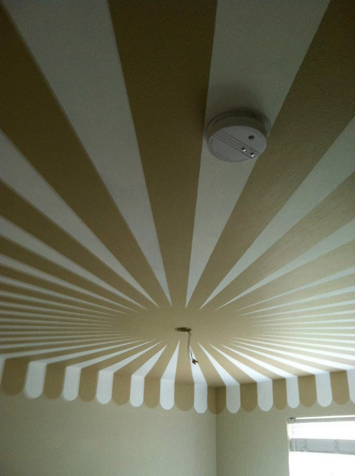 I was asked to make sure that the smoke alarm was disguised as much as possible, so I centered it in the white stripe.