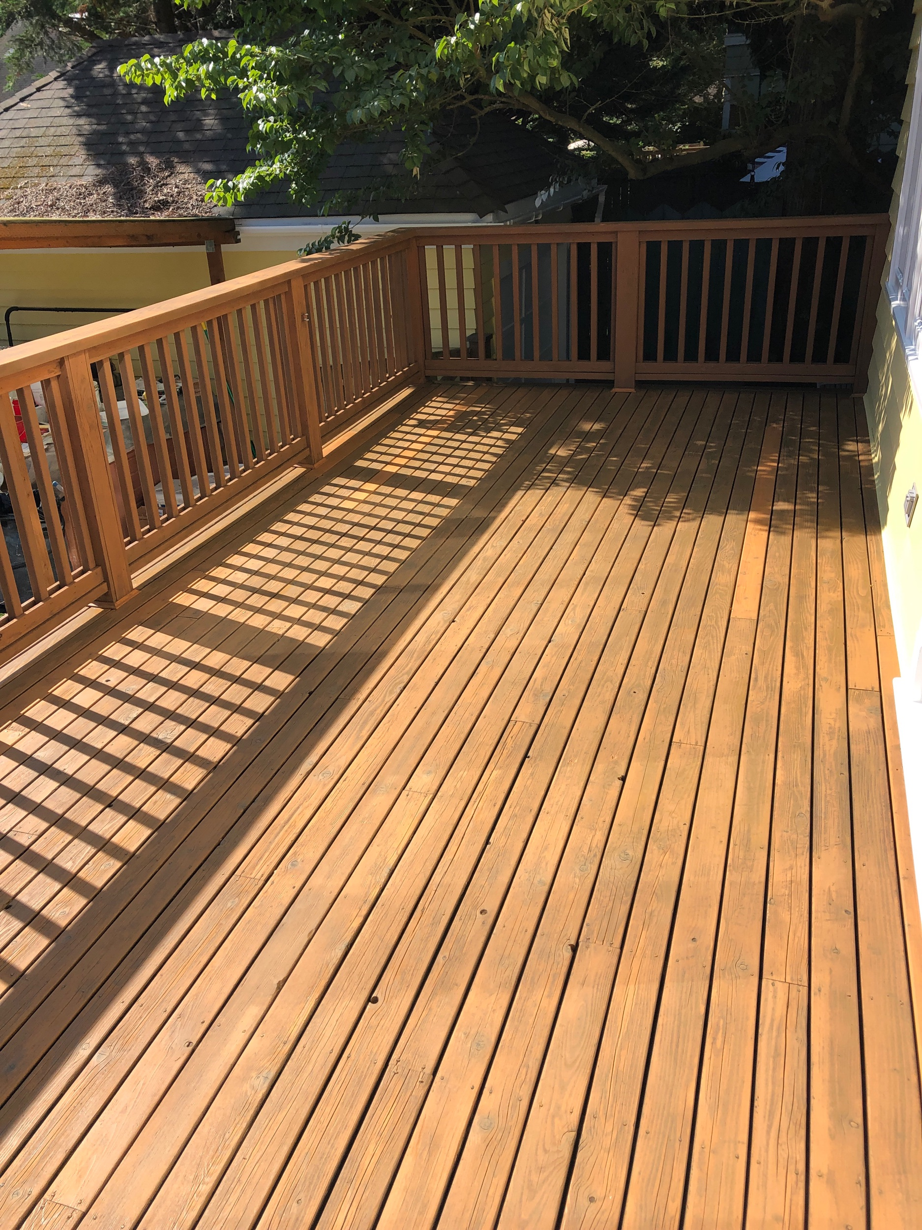 Sanded and stained old wooden Deck.