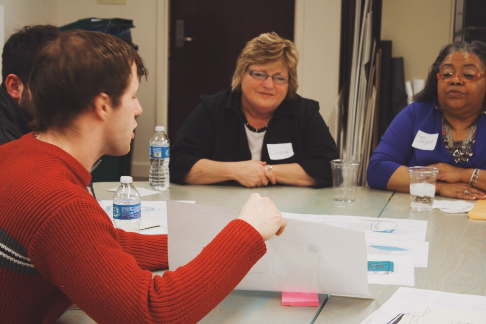 A student presenting a concept during a speed-dating co-creation session with the original cohort of customers.