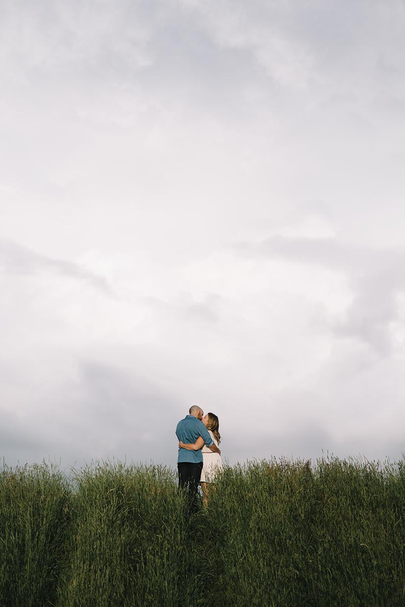 couple in a field, Lois Hole Park, Engagement Photographer St. Albert
