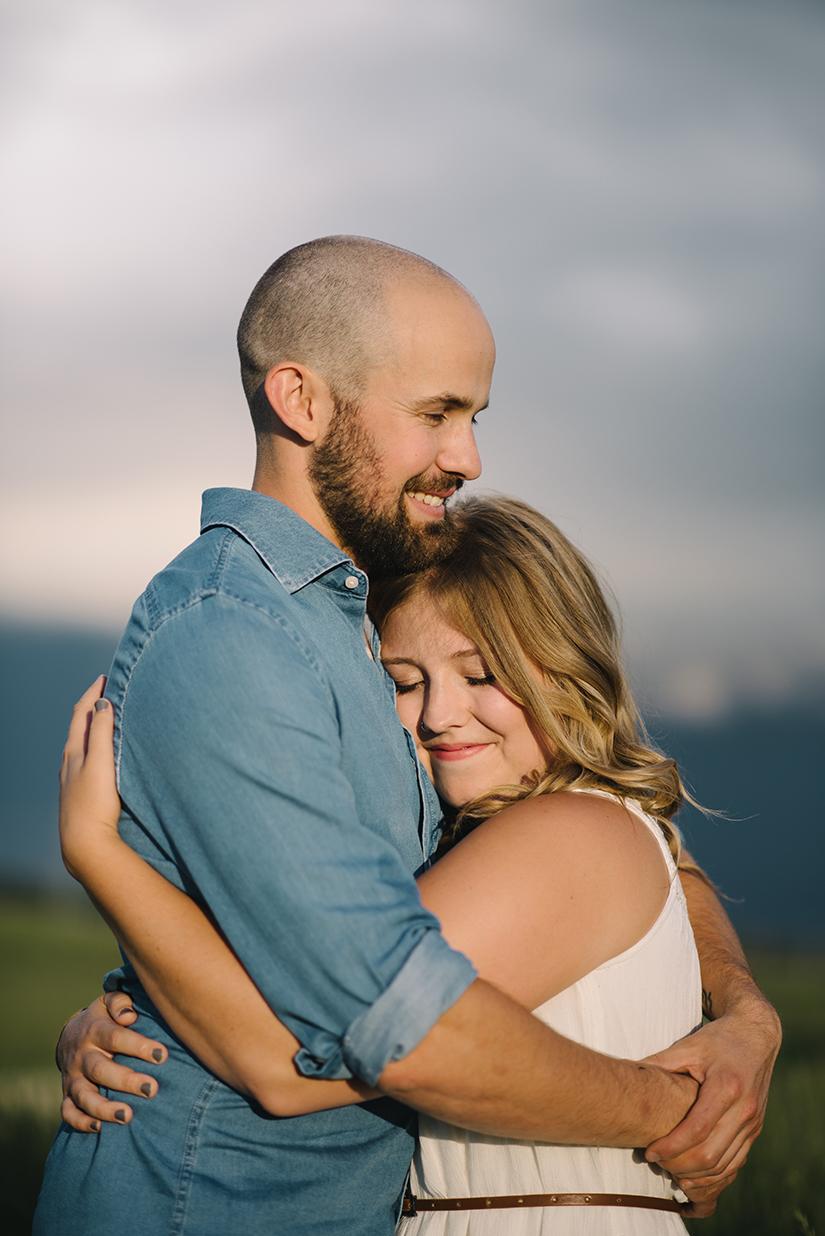 Hugging, bohemian couple, Engagement Photographer in St. Albert AB