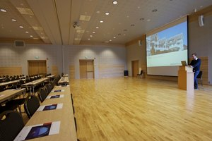 A modern conference room with no fewer than 4 projectors that can be used simultaneously.