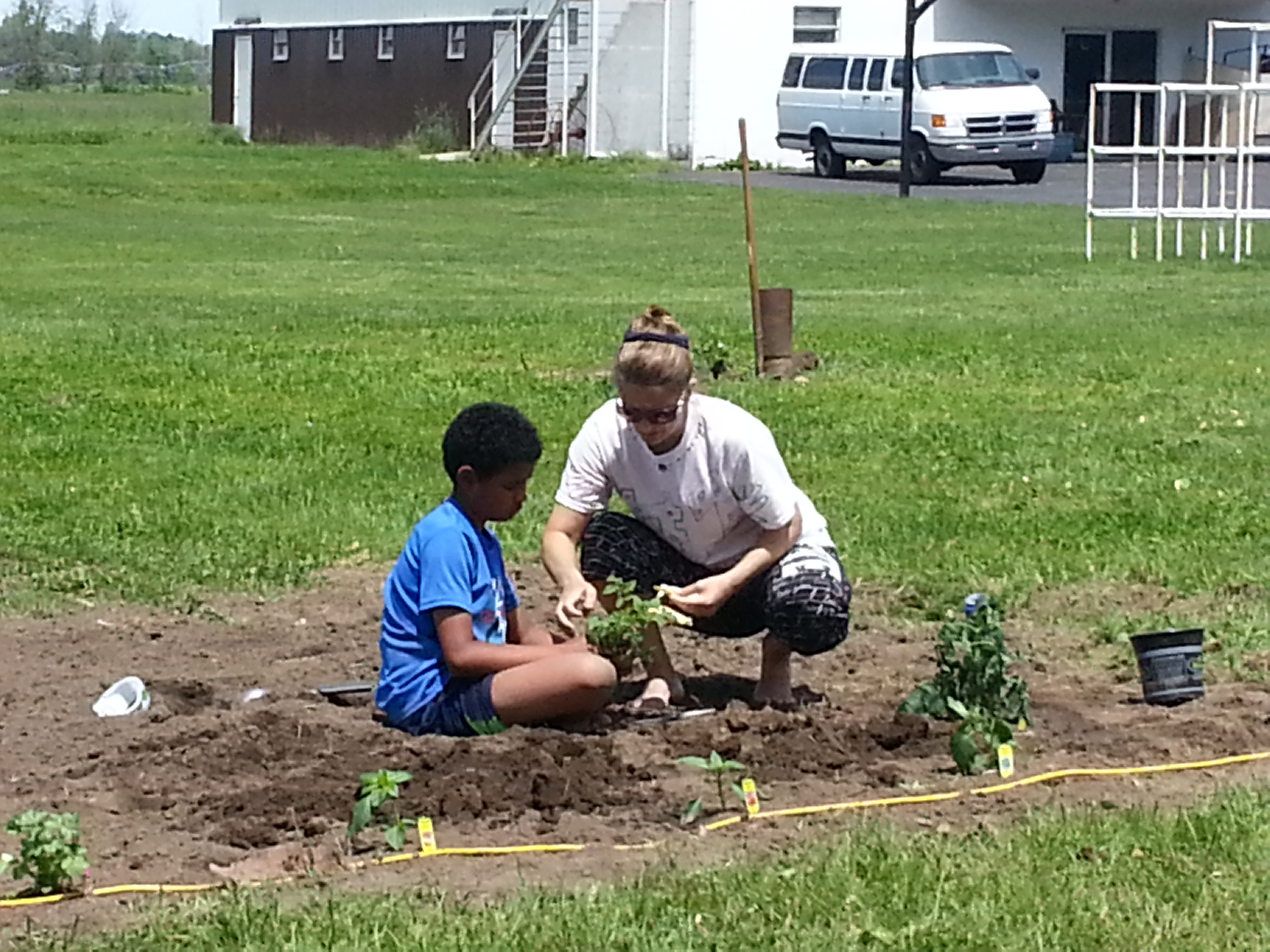 Aunt Tracy and Levi in their garden