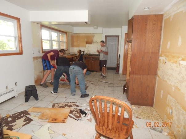 Demo work group working on removing the old cabinets.jpg