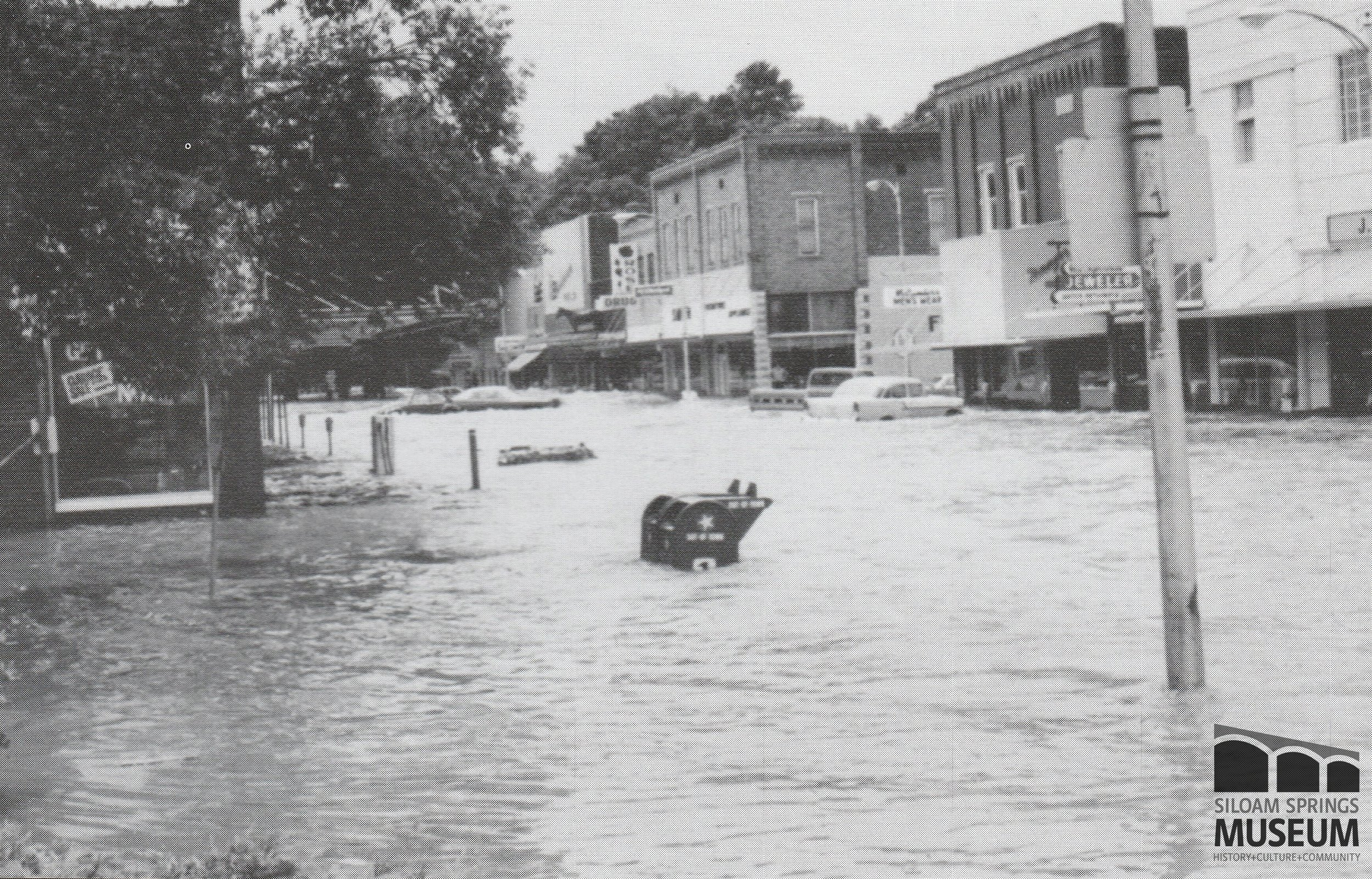 During the 1974 flood, parts of downtown Siloam Springs were under 7 feet of water.