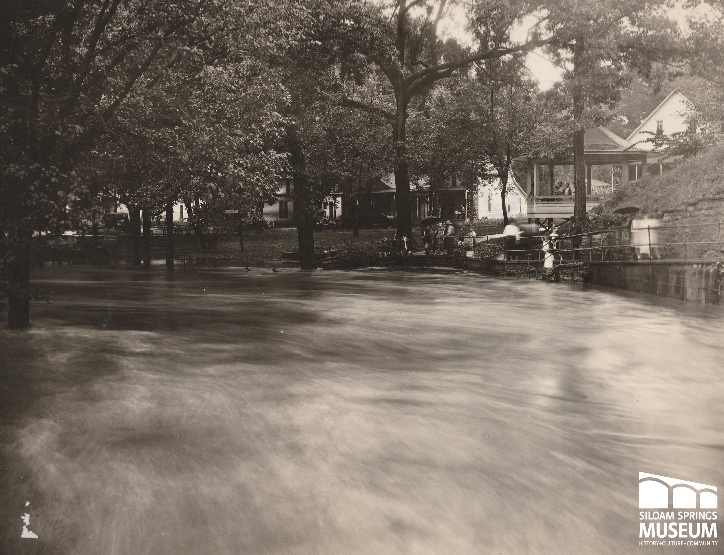 A crowd gathers on the south bank of Sager Creek, near Twin Springs.