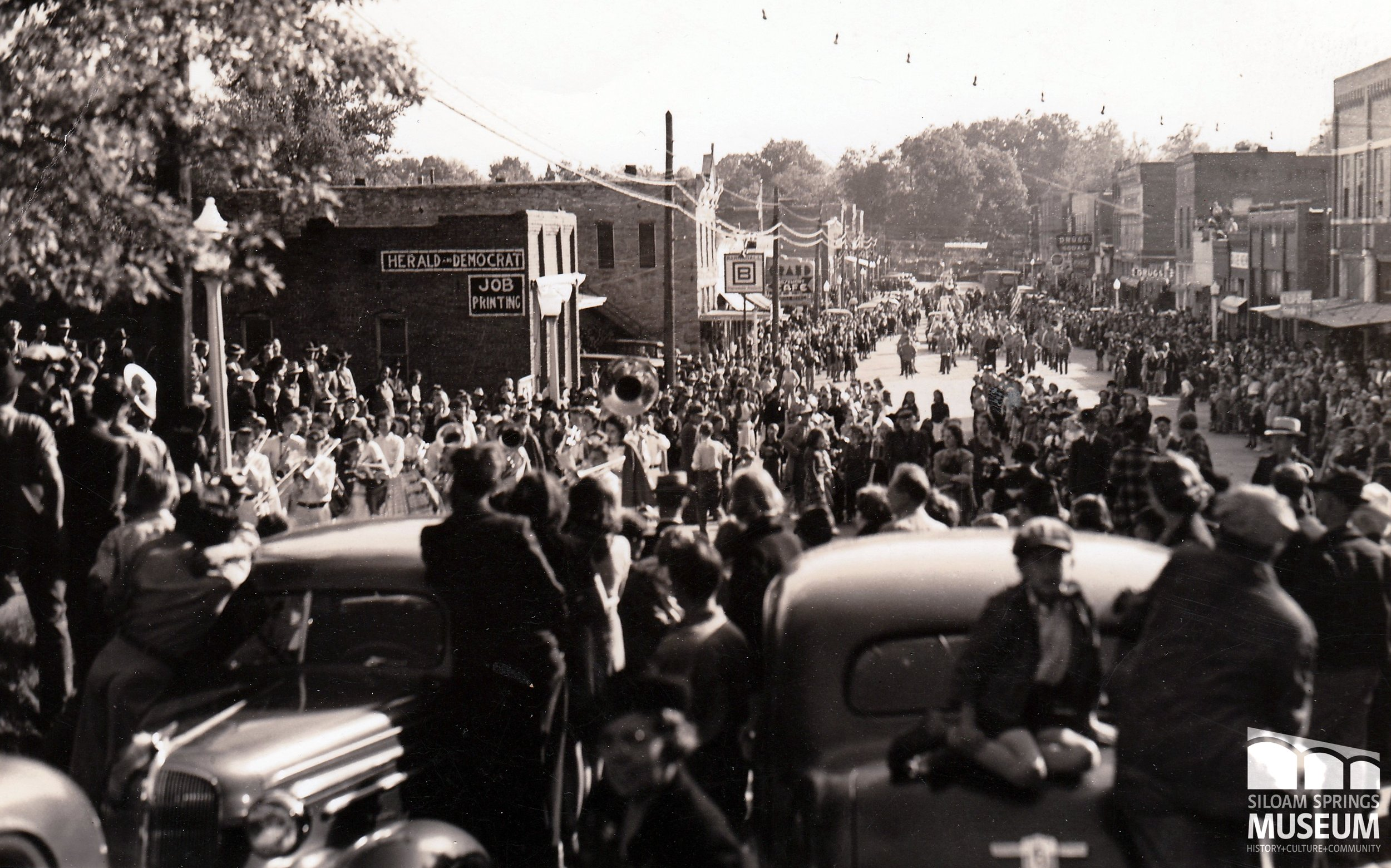 This parade in 1930's Siloam is possibly a St. John's Day celebration.