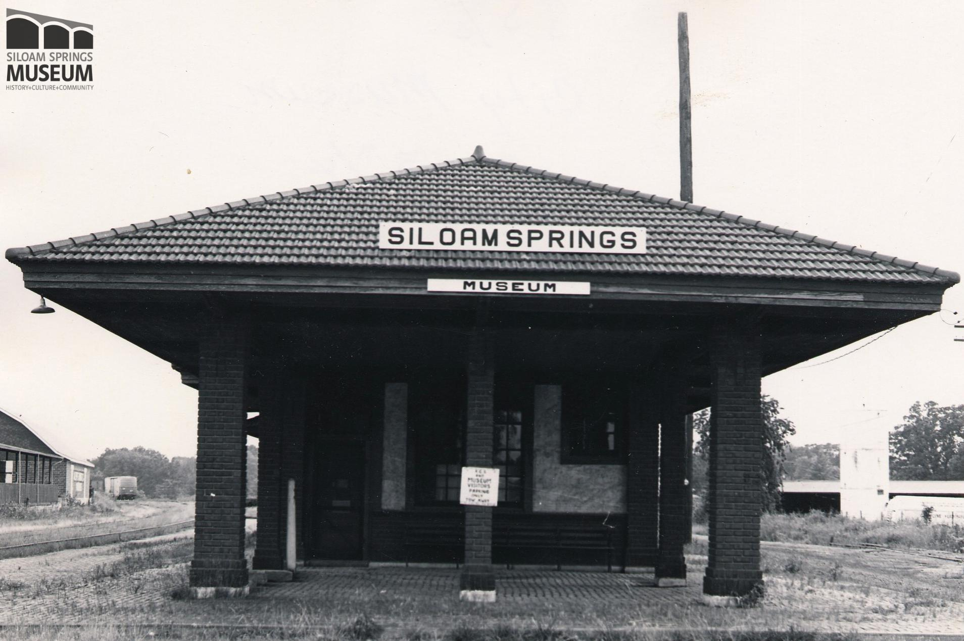 The disused passenger waiting area in the Kansas City Southern passenger depot served as the first location for the Siloam Springs Museum. This building burned down in the early 1990's, long after the museum moved to its current location.