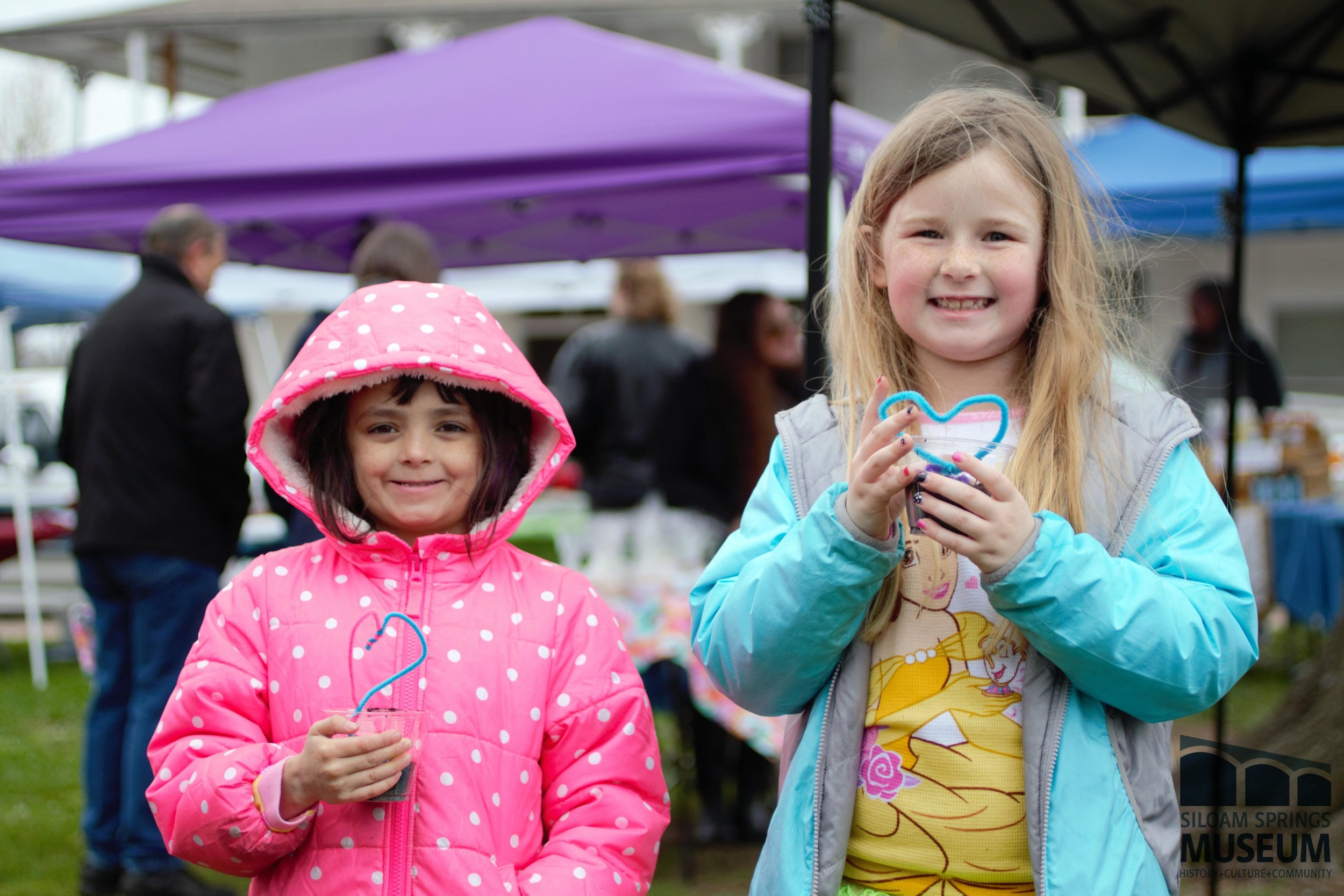 Two participants proudly display their crafts at this year's first Kids' Day at the Farmers Market on April 14. During its renovation, the museum will focus on events which promote education and bring the community of Siloam Springs together.