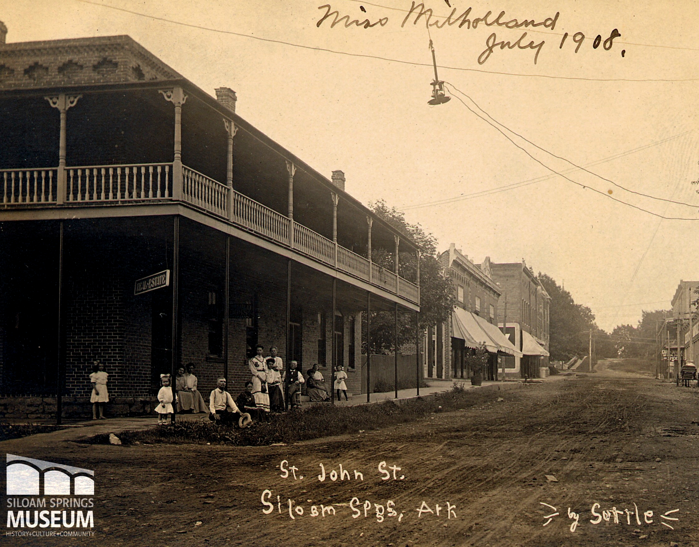 This 1908 photo looks east from the intersection of present day North Wright Street and West University Street. Notice how the poles on the Lakeside Hotel have no concrete at their bases.