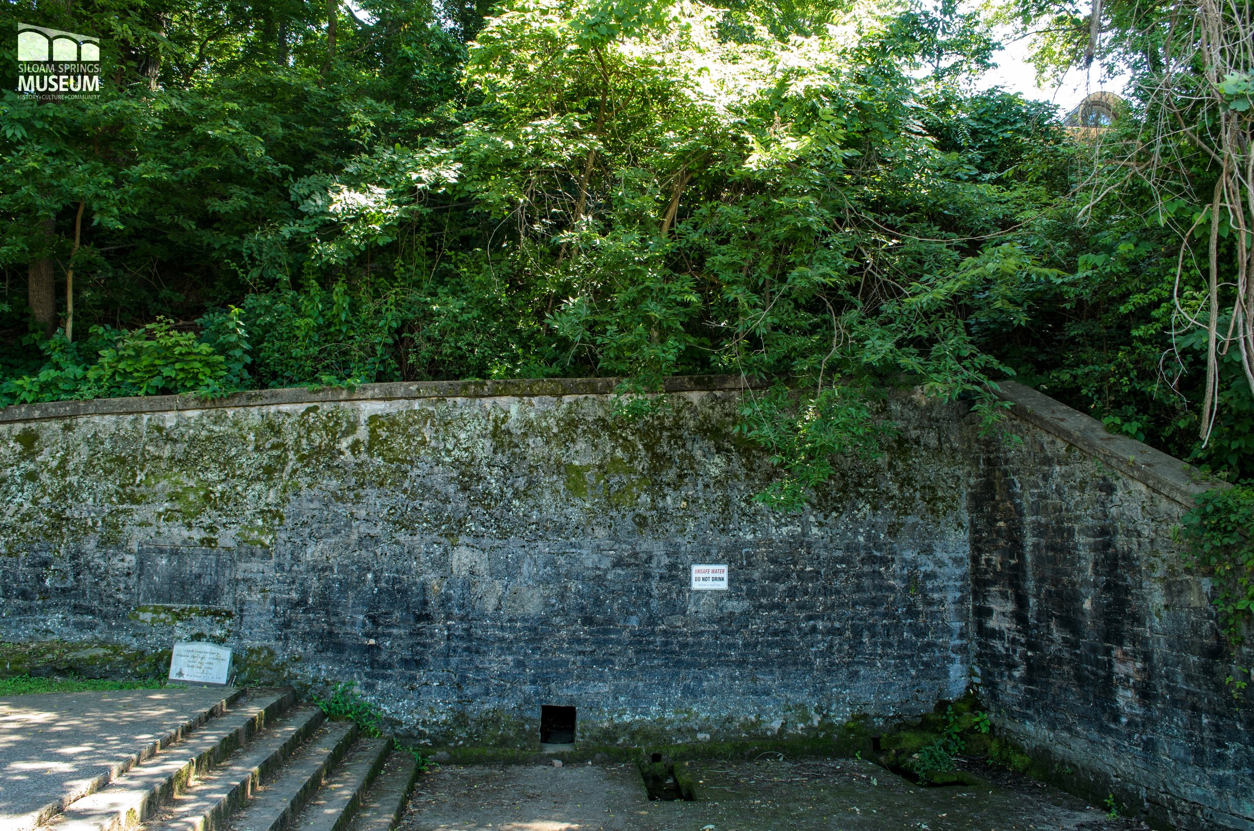 The 1897 wall still stands, but the natural rock shelf has once again been covered.