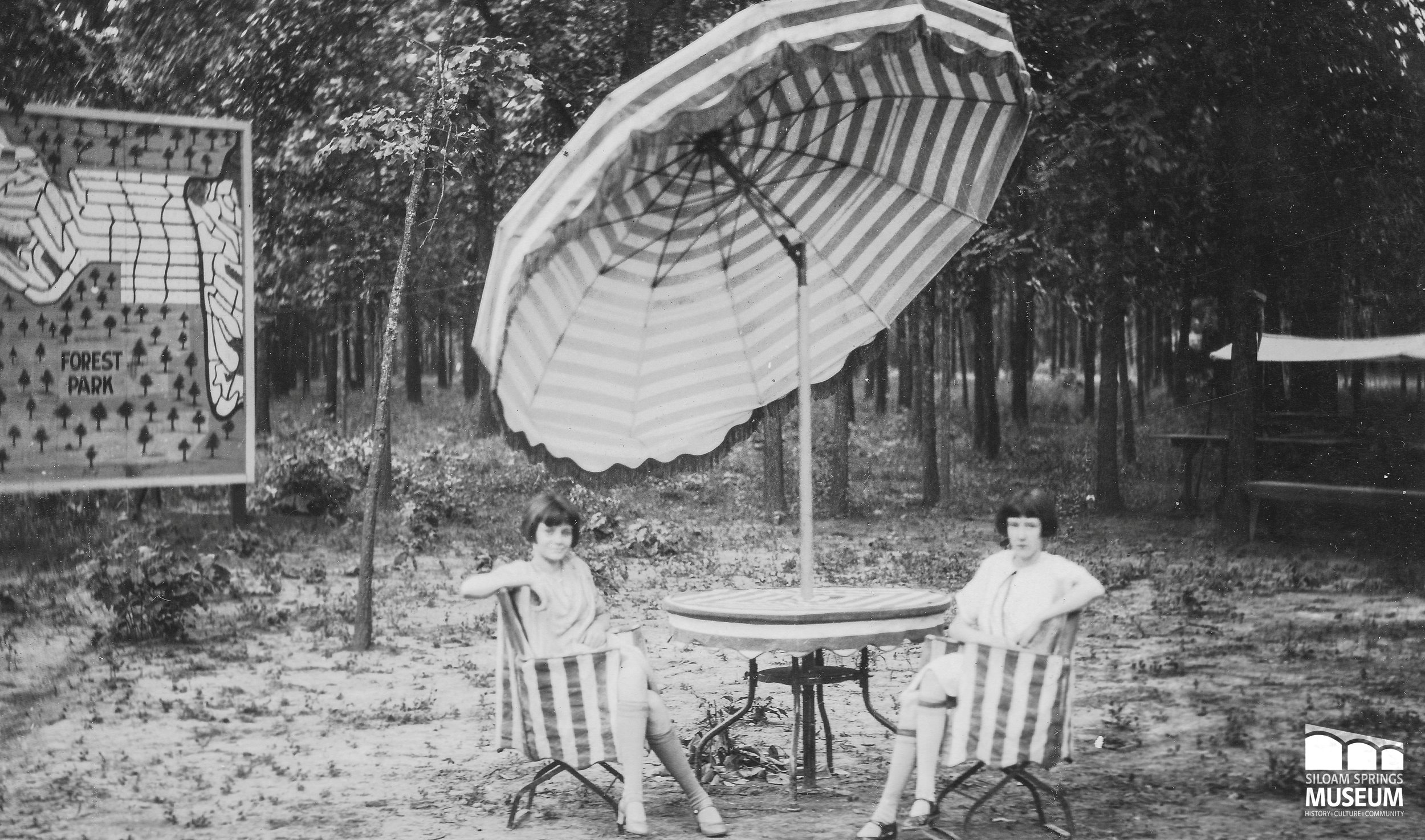 Two women sit at Forest Park's outdoor dining facilities.