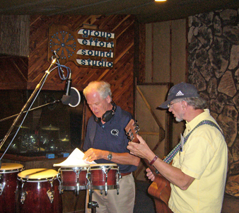 Dan Herzog and Pat Mayerchak reviewing lyrics