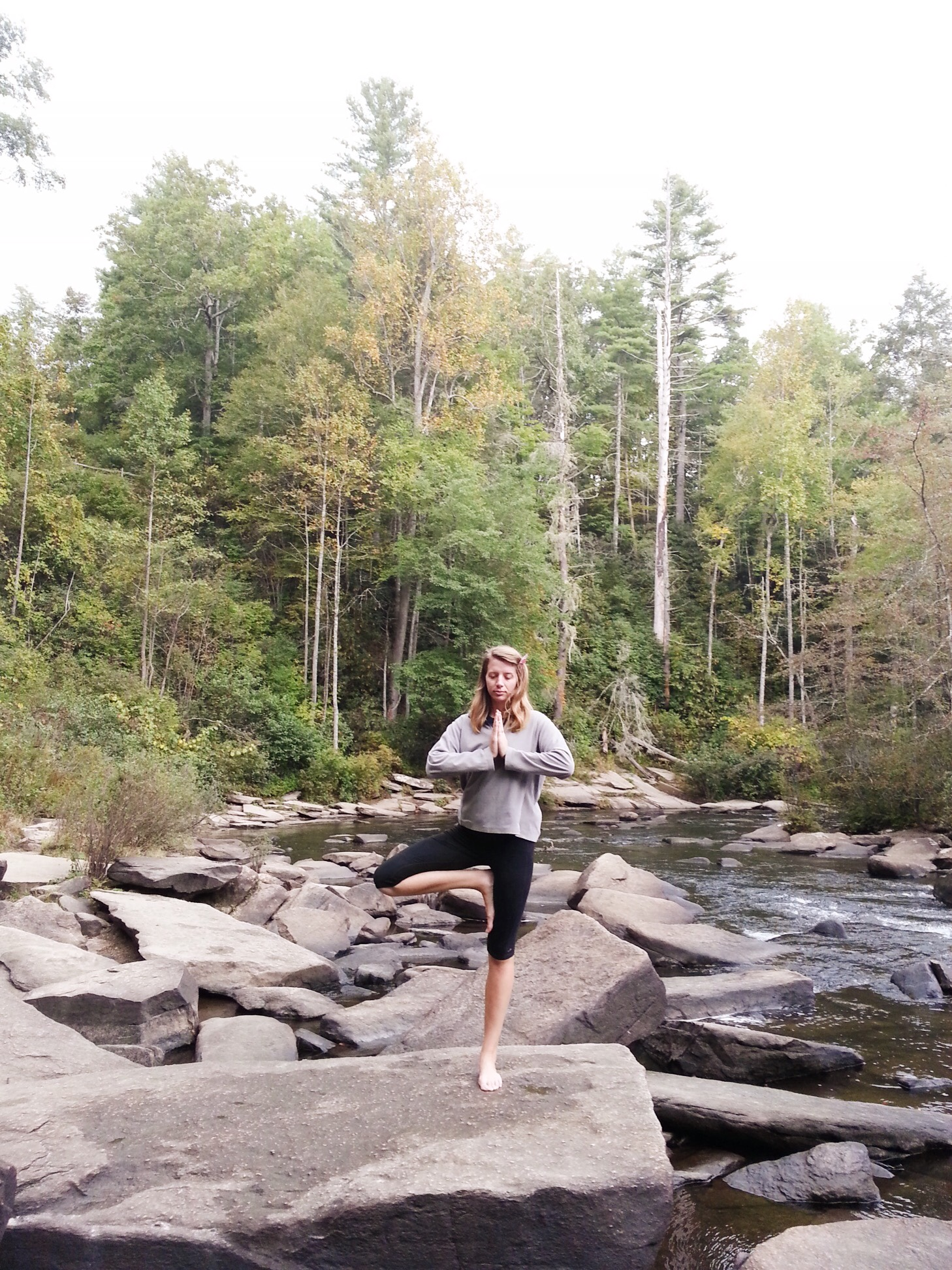 Yoga in nature at the bottom of a waterfall. Asheville, NC. 2014.