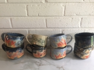 Mugs ready for the gold glaze and the third, and final firing!