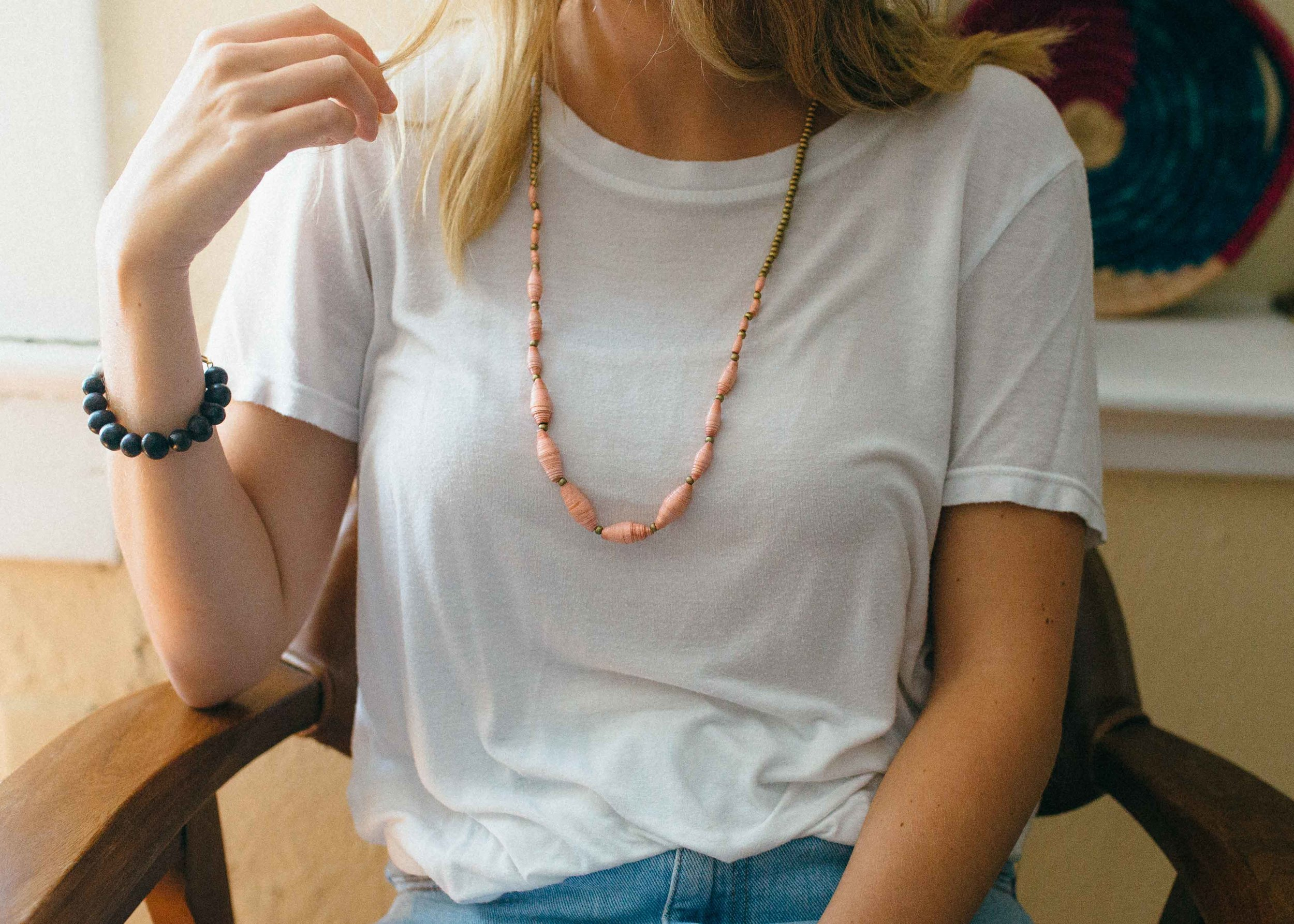 Our model wears the Amora necklace and Miriam bracelet.