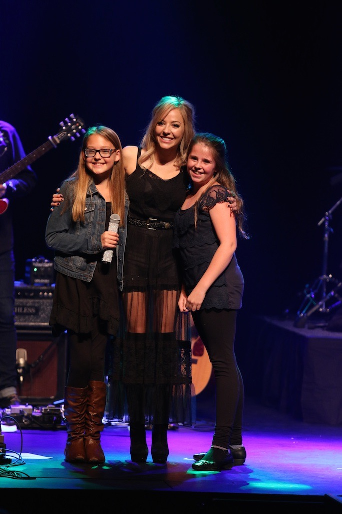 Mackenzie Porter invited me and my friend Sophie up onstage at her concert in Medicine Hat, AB 2015. Check out my u-tube channel to see me taking Mackenzie up on her gracious invitation for me to share my story.