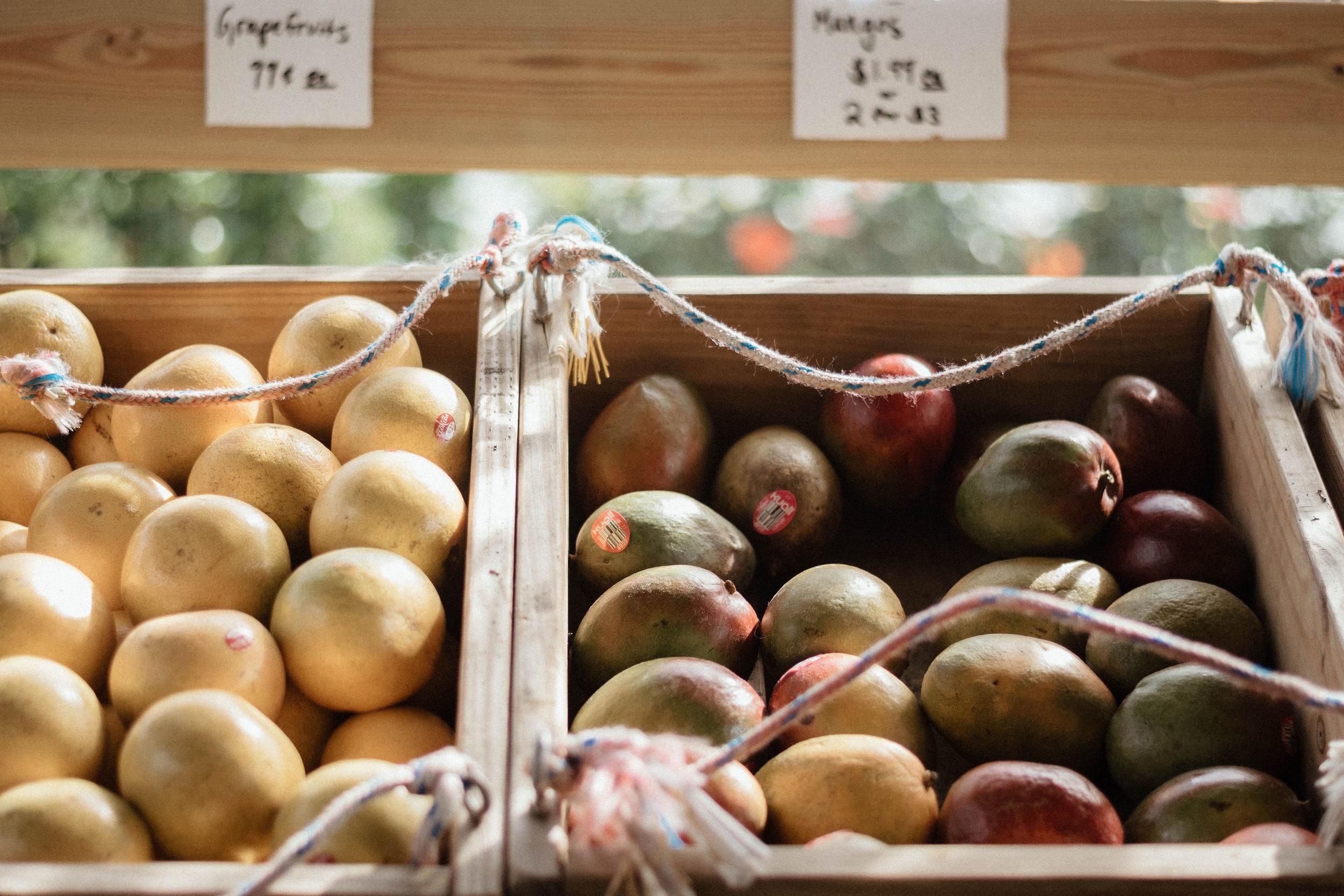 mangos in wooden bin