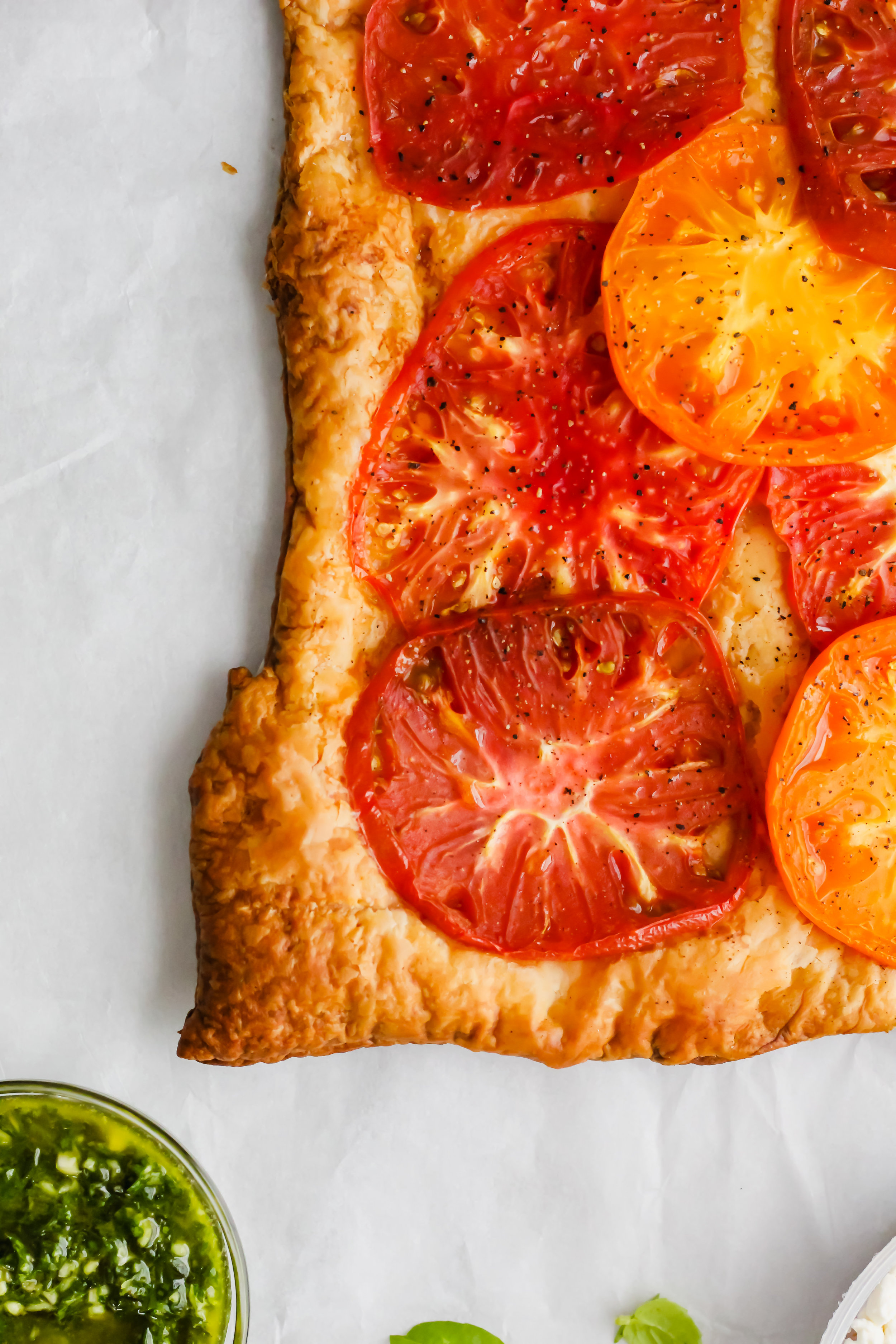 tomato tart with pesto on white background