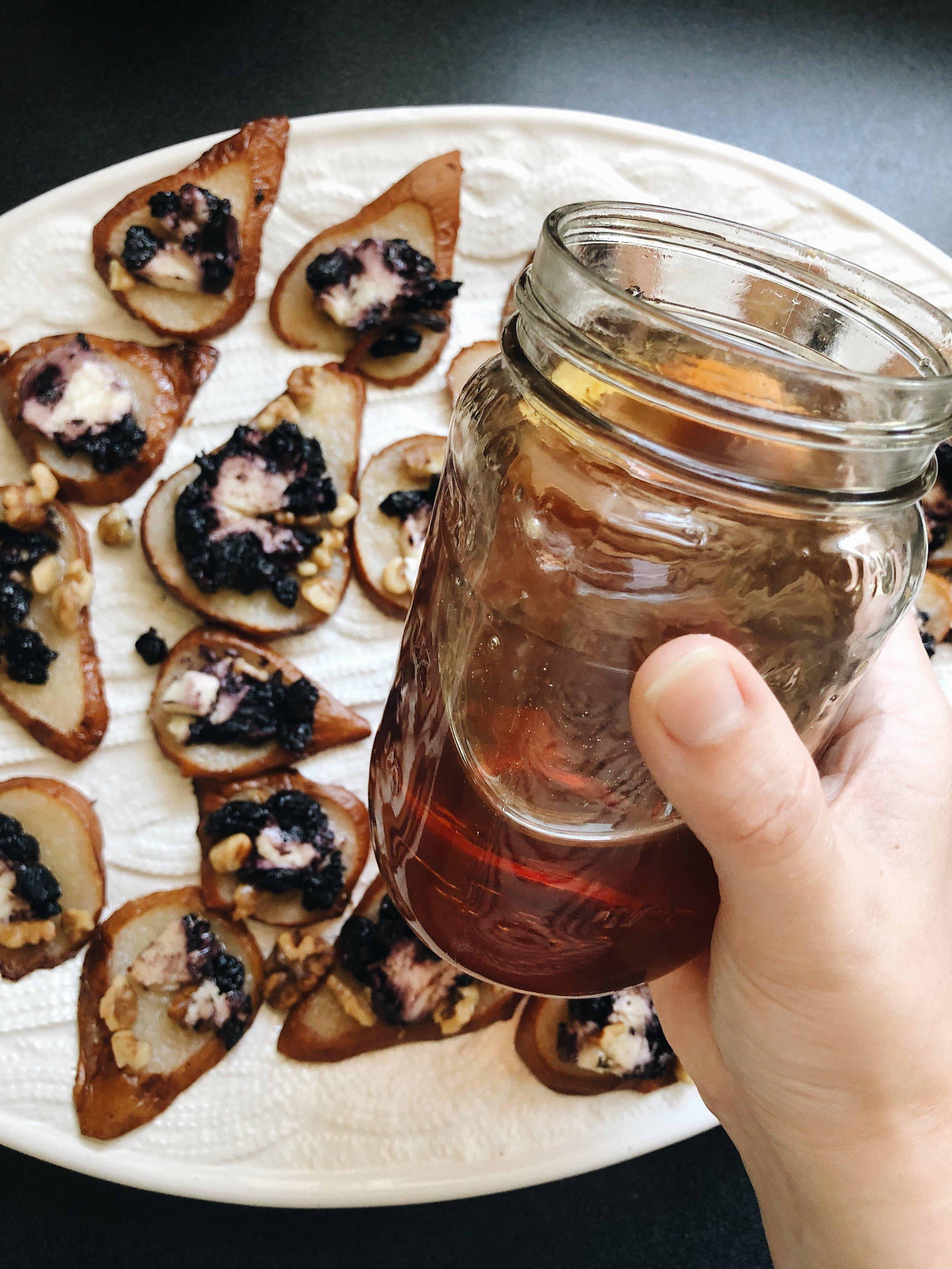 hand holding honey jar