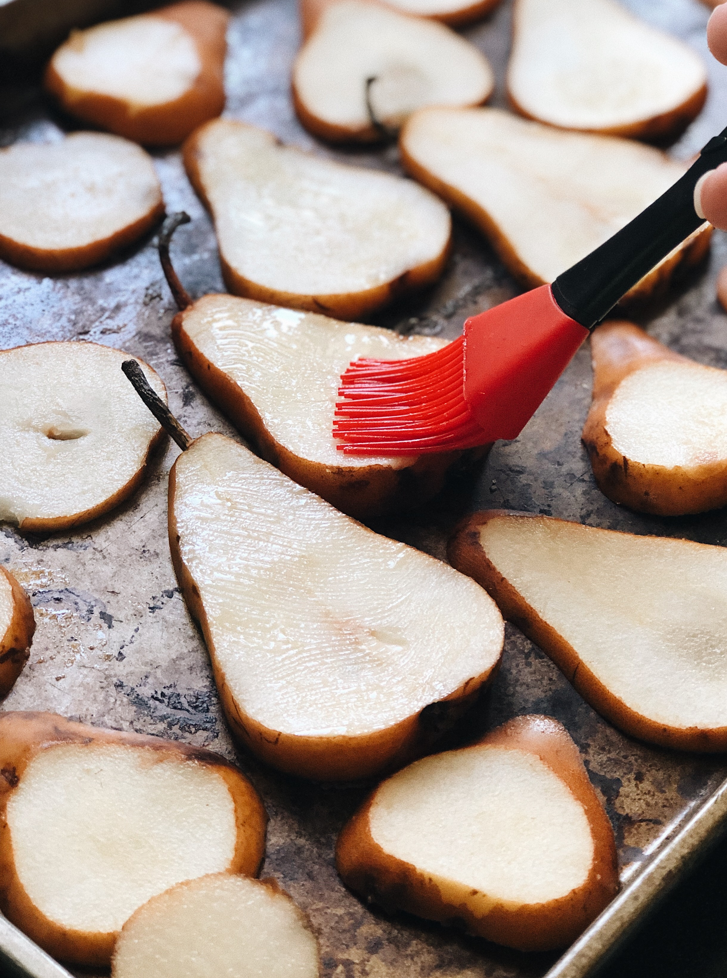 red brush topping pears with butter