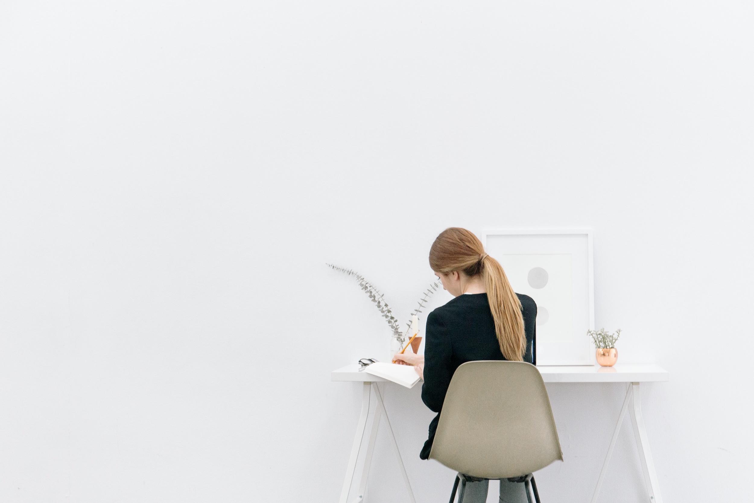 Female sat at desk designing a website