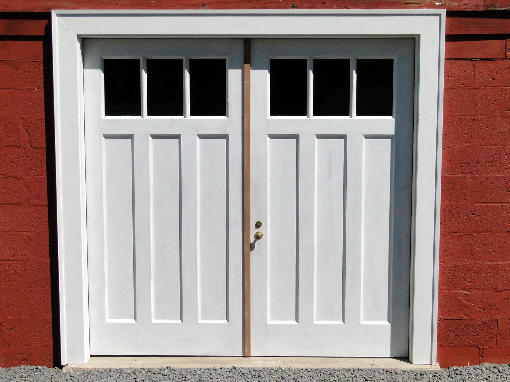 Garage doors in painted mahogany