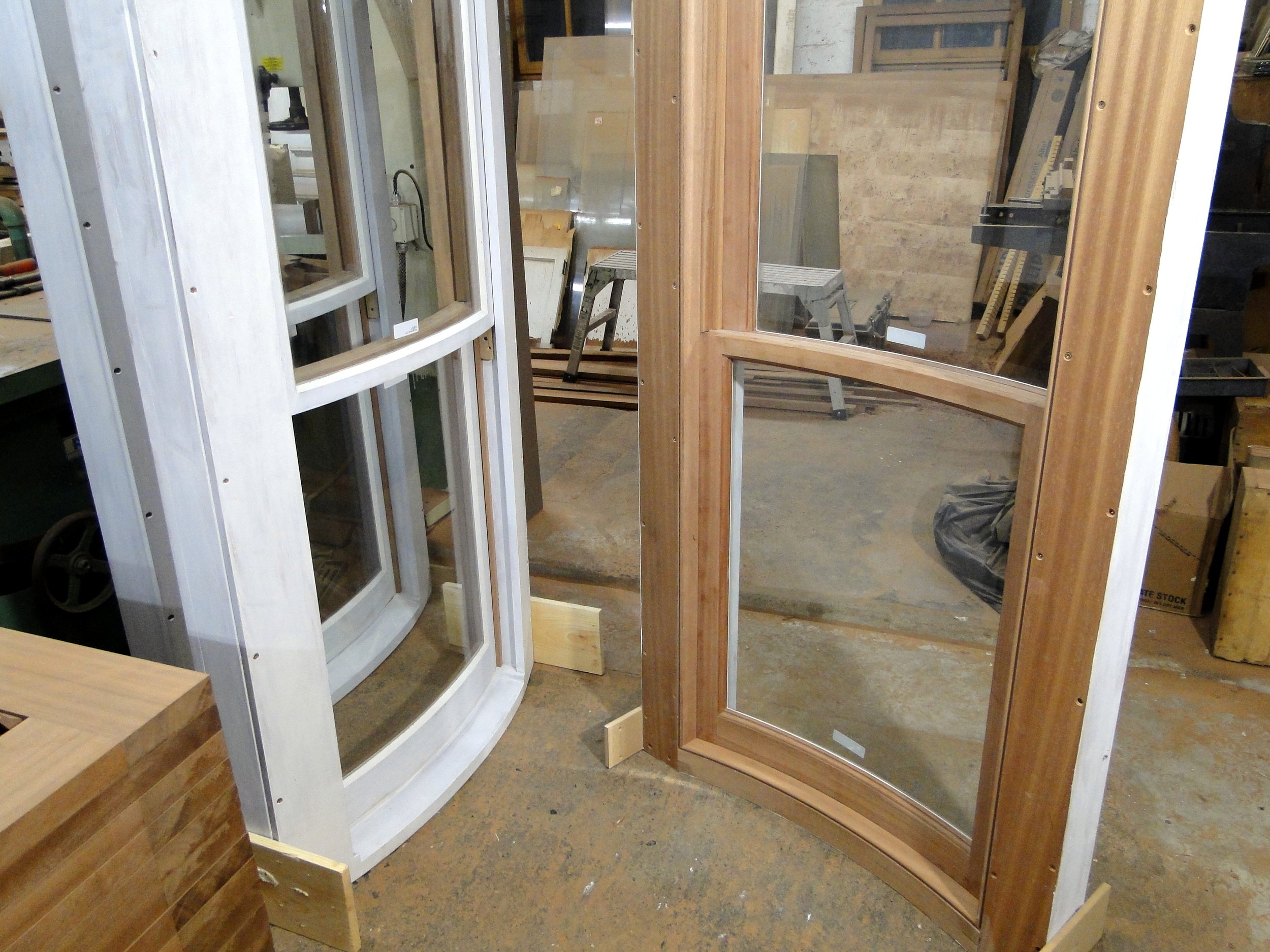 Our traditional double hung bow window in primed mahogany - available in several species of wood. Bronze or zinc interlocking metal weather stripping. Several options for glass including Restoration Glass. Also several options for lift systems including weight and pulley counterbalance with rope or chain. Wood storms and screens.
