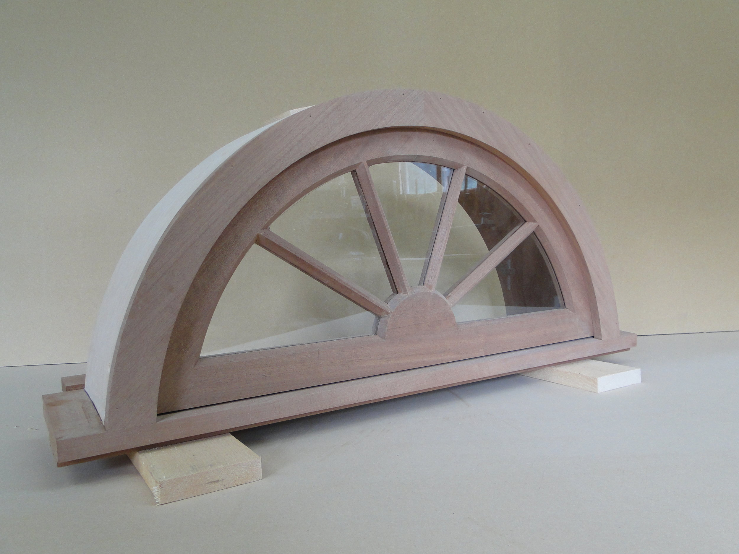 Arched window in mahogany