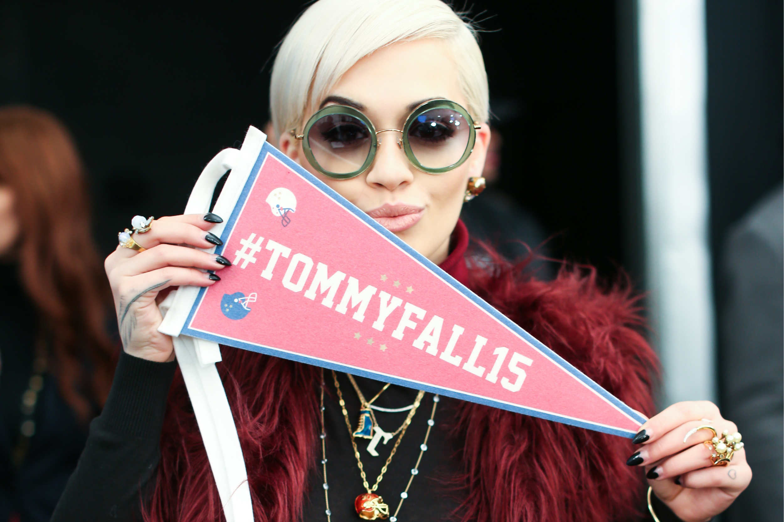 Rita Ora  waving her pennant for team Tommy!