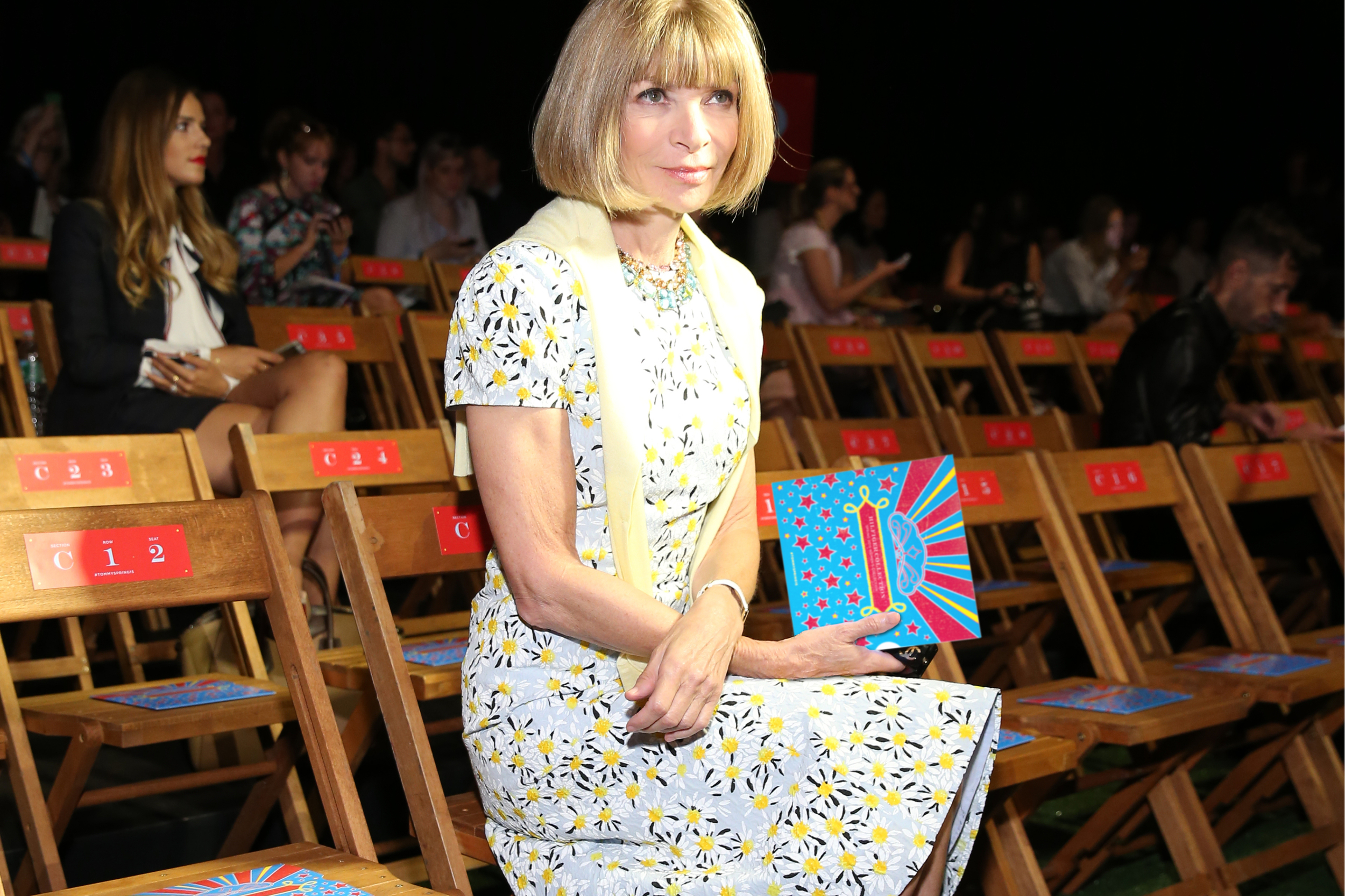 Anna Wintour  compliments the design in her floral dress.
