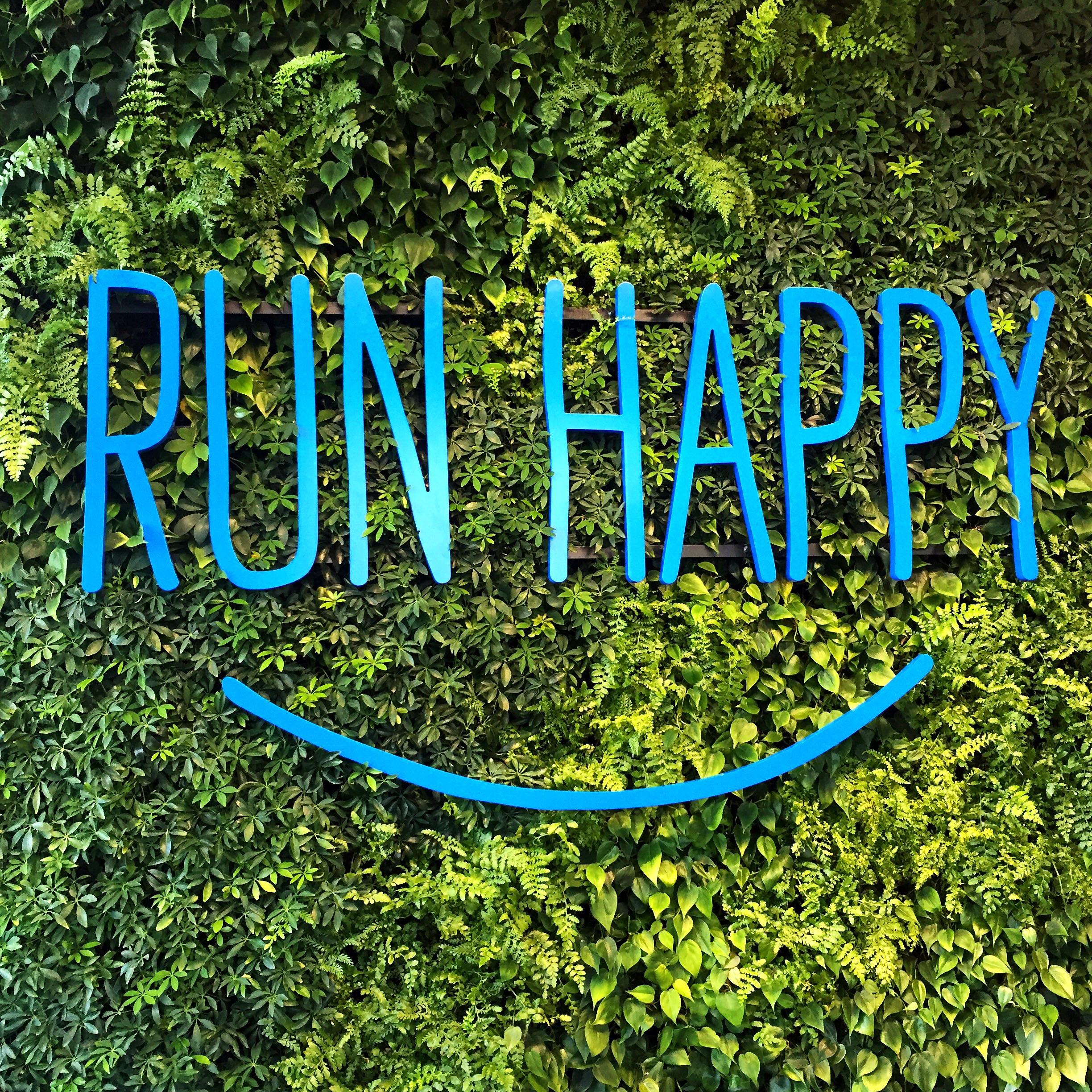 "The Brooks motto ""Run Happy"" welcomes visitors at their HQ and storefront in the Fremont neighborhood of Seattle."