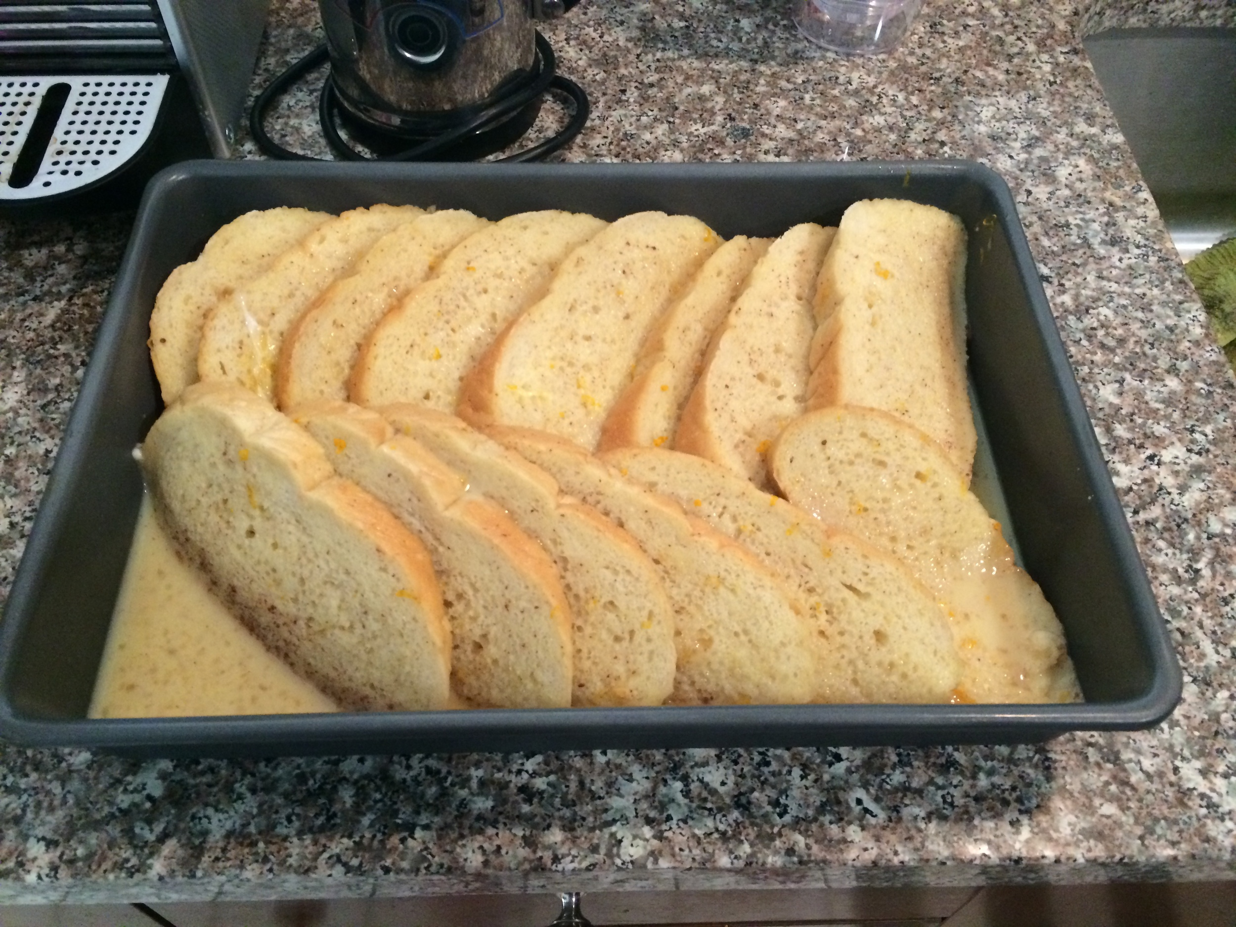 French Toast sits overnight to allow egg mixture to soak into the bread.