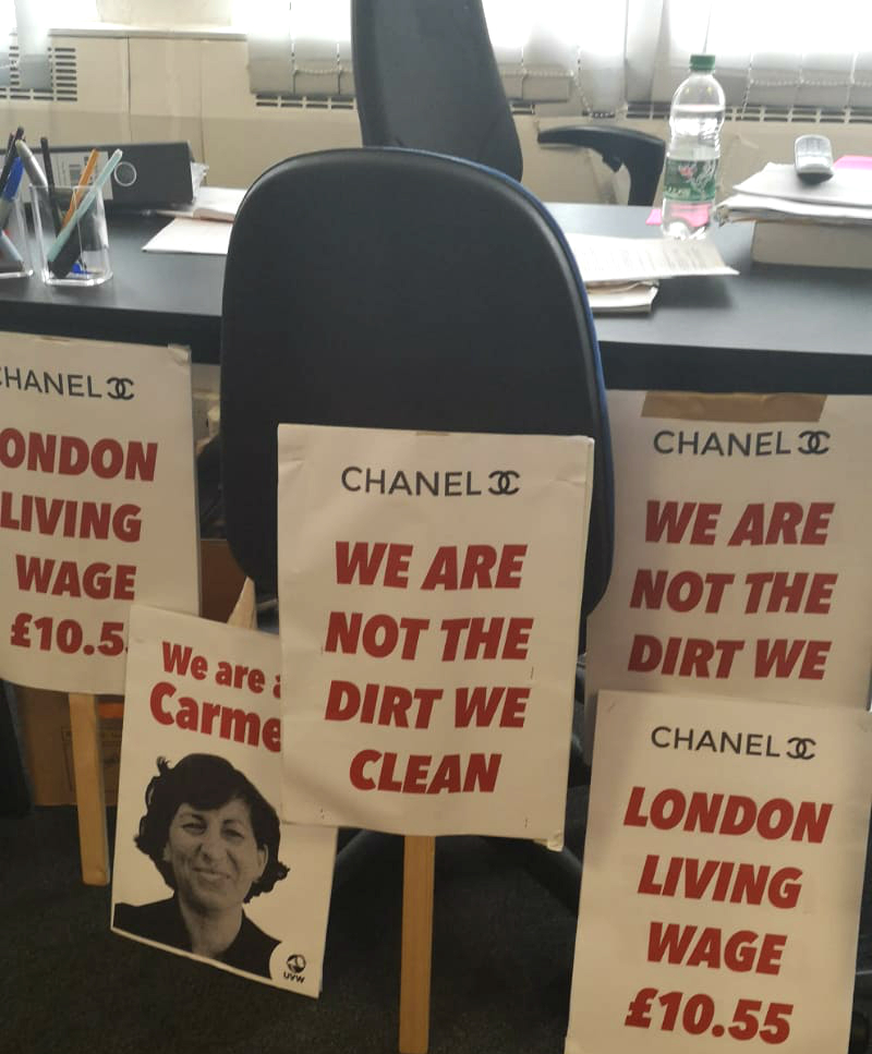 - Cleaners at a Chanel store were Latin Americans employed by Bayleaf Cleaning. Their dispute was over low pay and understaffing, but soon included the unfair suspension of a colleague who had been a leading organiser of the cleaning group.A partial victory in March saw the cleaners awarded a 10% pay rise, from £8.21 to £9.10 per hour, after they made it clear they were willing to strike. This was still well short of the £10.55 plainly within reach (not to mention the £2,000 price tags on some of the handbags), so with the other demands still not forthcoming, the cleaners subsequently decided to ballot for strike action.The placards and a large banner were ready and waiting, along with drums and (rumoured) stink bombs, to be deployed on the narrow New Bond Street where Chanel, Dior, Louis Vuitton and Hermes have gleaming storefronts.Naturally, Chanel's managers did not want to be embarrassed in front of their glitzy neighbours — all for the sake of skimping on their own cleaners.At last, a decision was made by Chanel to concede most if not all demands. The evening before the protest, emails then phone calls put a stop to the dispute. The London Living Wage of £10.55 was confirmed in writing. Negotiations were then concluded to mutual agreement in July 2019.
