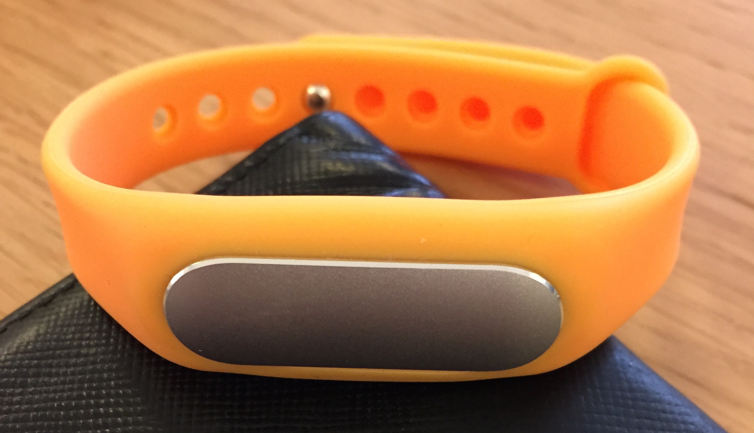 Actually, I think this orange band is probably a knockoff. Oops. I ordered it from a 3rd party site and... who cares it is orange and dope