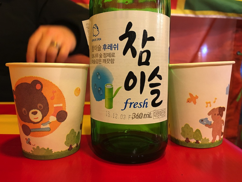 EY can't I just enjoy my soju in a tent without some bear trying to tell me how to brush my teeth!?! And what does that musical dog think he is doing with that fish?!